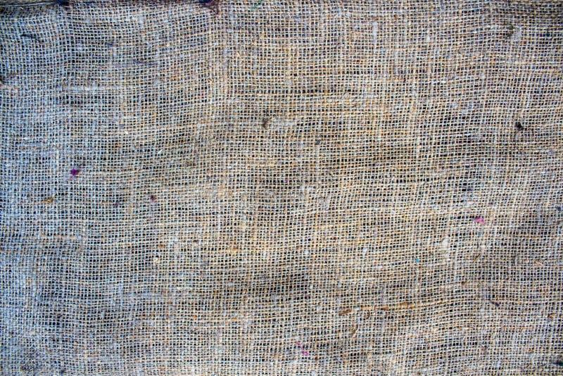 Ένα υπόβαθρο με sackcloth στον πίνακα στοκ εικόνες