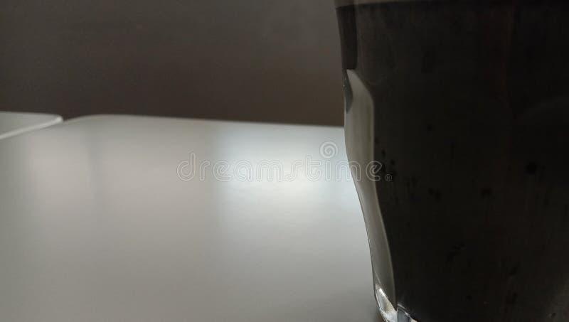 Ένα φλυτζάνι του μαύρου καφέ capucino στοκ εικόνα