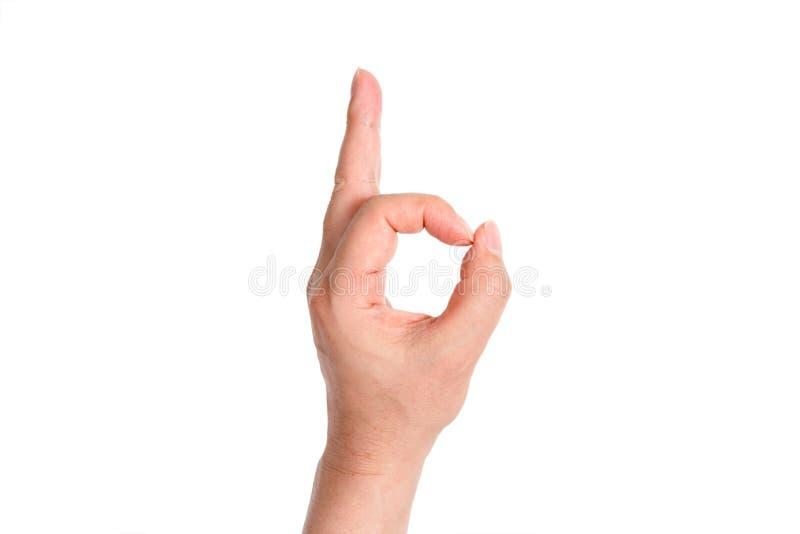 Ένα χέρι ατόμων ` s που δίνει το βράχο - και - κυλά το σημάδι στοκ φωτογραφίες