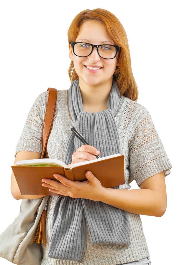 Ένα χαμόγελο hipstergirl με το σημειωματάριο στοκ φωτογραφίες με δικαίωμα ελεύθερης χρήσης
