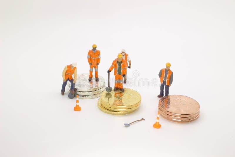 ένα Bitcoin με λίγο αριθμό για τα νομίσματα στοκ φωτογραφία