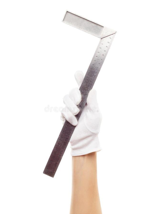 Ένα straightedge στο χέρι, που απομονώνεται στοκ εικόνες