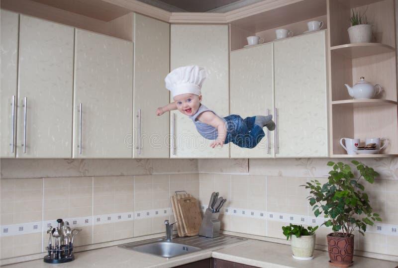Έννοια αρχιμαγείρων ελκυστικό μωρό στοκ εικόνες