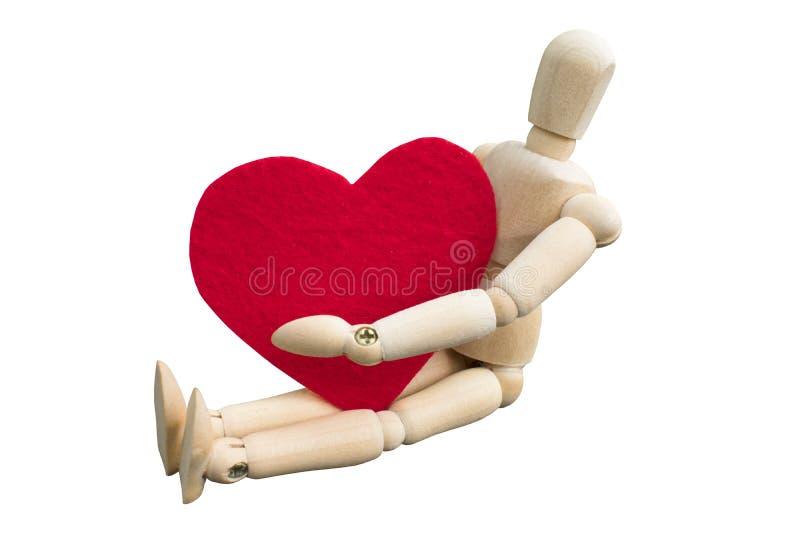 Έννοια ημέρας βαλεντίνων ` s Ξύλινο πλαστό αγκάλιασμα μια μορφή καρδιών που έκανε από το ακρυλικό αισθητό ύφασμα στοκ εικόνα