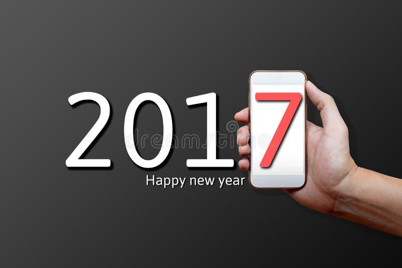2017 έννοια καλής χρονιάς, μέλος του σώματος, χέρι που κρατά το κινητό phon στοκ εικόνα με δικαίωμα ελεύθερης χρήσης