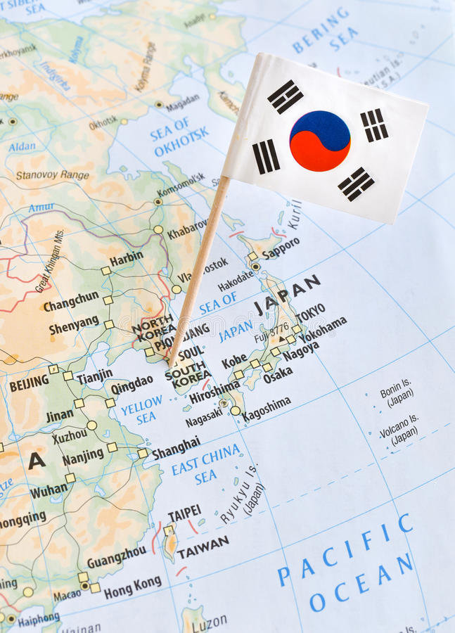 Έννοια παγκόσμιων καυτών σημείων καρφιτσών χαρτών και σημαιών της Νότιας Κορέας στοκ φωτογραφίες