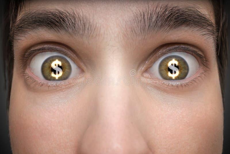 Έννοια παιχνιδιού Ο νεαρός άνδρας έχει τα σημάδια δολαρίων στα μάτια του στοκ εικόνες
