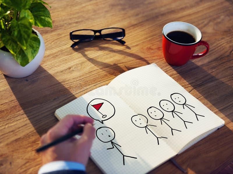 Έννοια στόχου σχεδίων επιχειρηματιών σε ένα σημειωματάριο στοκ φωτογραφία
