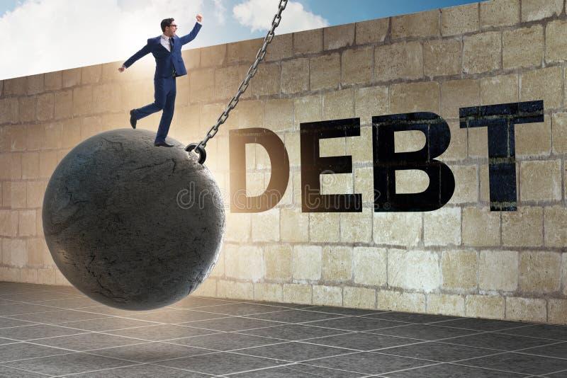 Έννοια χρέους και δανείου με τον επιχειρηματία στοκ φωτογραφία