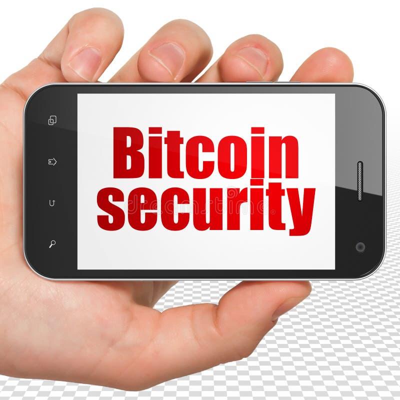 Έννοια Blockchain: Εκμετάλλευση Smartphone χεριών με την ασφάλεια Bitcoin στην επίδειξη στοκ φωτογραφία