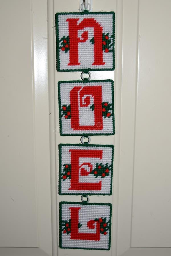 Ένωση σημαδιών Noel Χριστουγέννων στην πόρτα στοκ φωτογραφία
