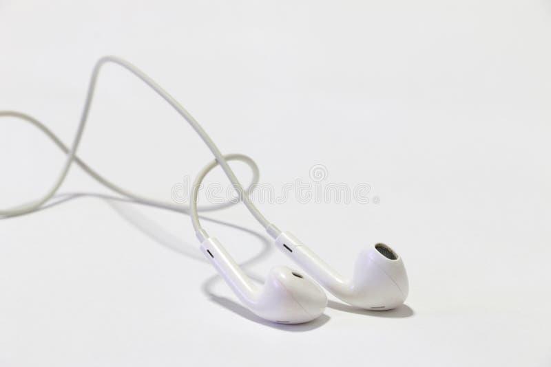 Έξυπνο τηλέφωνο με τα ακουστικά στοκ φωτογραφία με δικαίωμα ελεύθερης χρήσης
