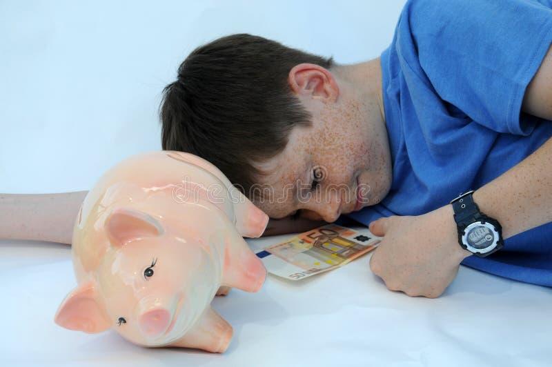 Έφηβος με τη piggy τράπεζα στοκ φωτογραφίες με δικαίωμα ελεύθερης χρήσης