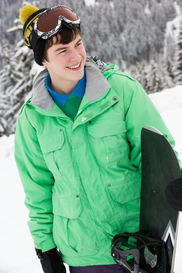 Έφηβος με το σνόουμπορντ στις διακοπές σκι στοκ εικόνες με δικαίωμα ελεύθερης χρήσης