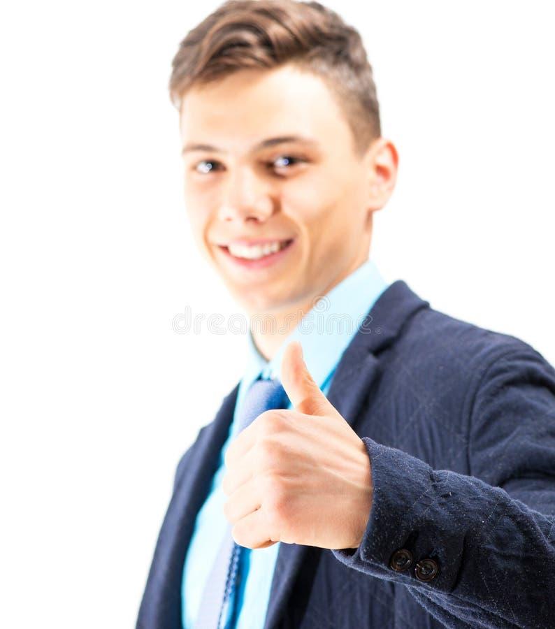 Έφηβος που κάνει σήμα ΕΝΤΆΞΕΙ με τα χέρια του που απομονώνονται στο λευκό στοκ φωτογραφία