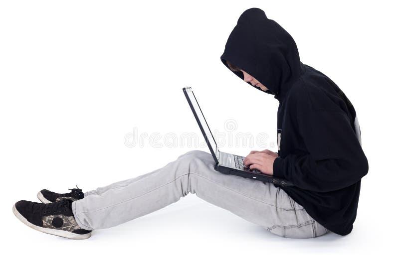 έφηβος lap-top χάκερ στοκ εικόνα με δικαίωμα ελεύθερης χρήσης
