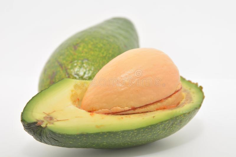Αβοκάντο φρέσκα πράσινα τροπικά τρόφιμα διατροφής βιταμινών τροφίμων φρούτων εξωτικά στοκ εικόνα με δικαίωμα ελεύθερης χρήσης