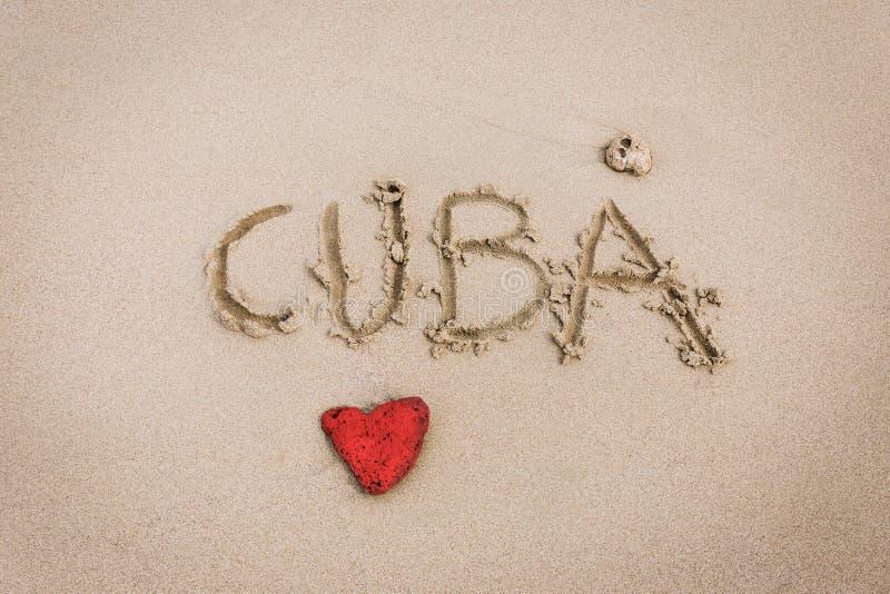 Αγάπη της Κούβας στην άμμο στοκ εικόνες