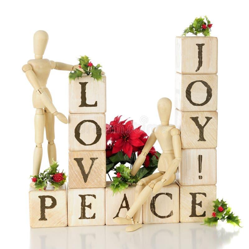 Αγάπη, χαρά, και ειρήνη Χριστουγέννων στοκ φωτογραφία