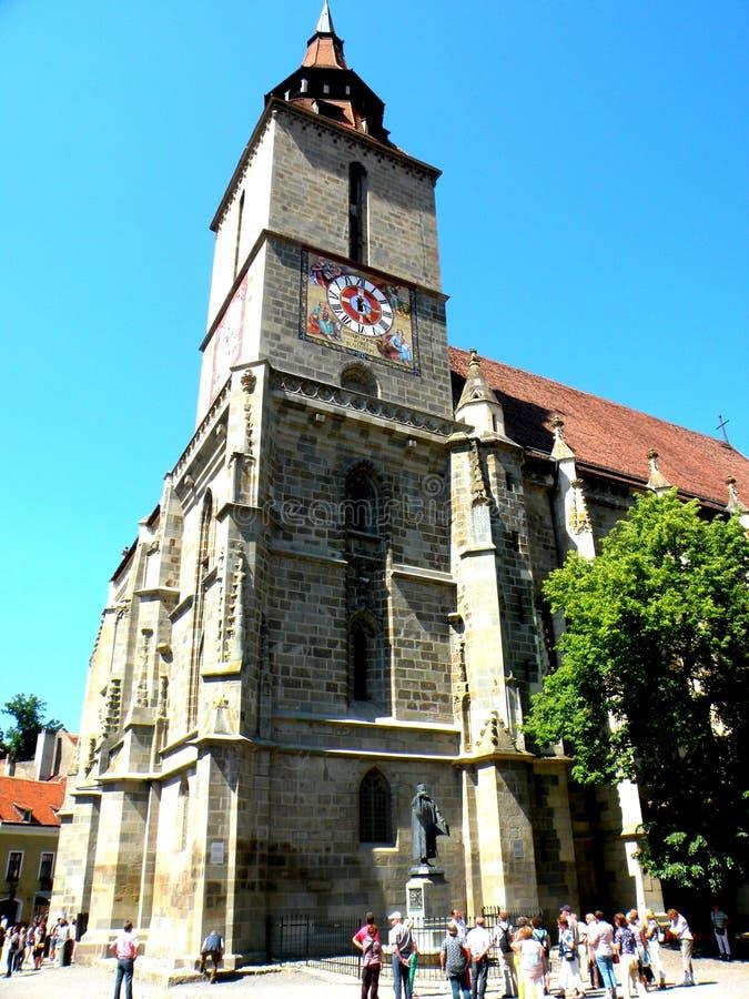 Αγάλματα Honterus στο μέτωπο της μαύρης εκκλησίας σε Brasov (Kronstadt), Transilvania, Ρουμανία στοκ εικόνα