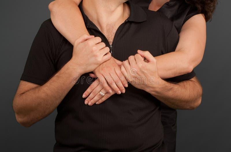 Αγαπώντας ζεύγος στο Μαύρο στοκ εικόνα με δικαίωμα ελεύθερης χρήσης