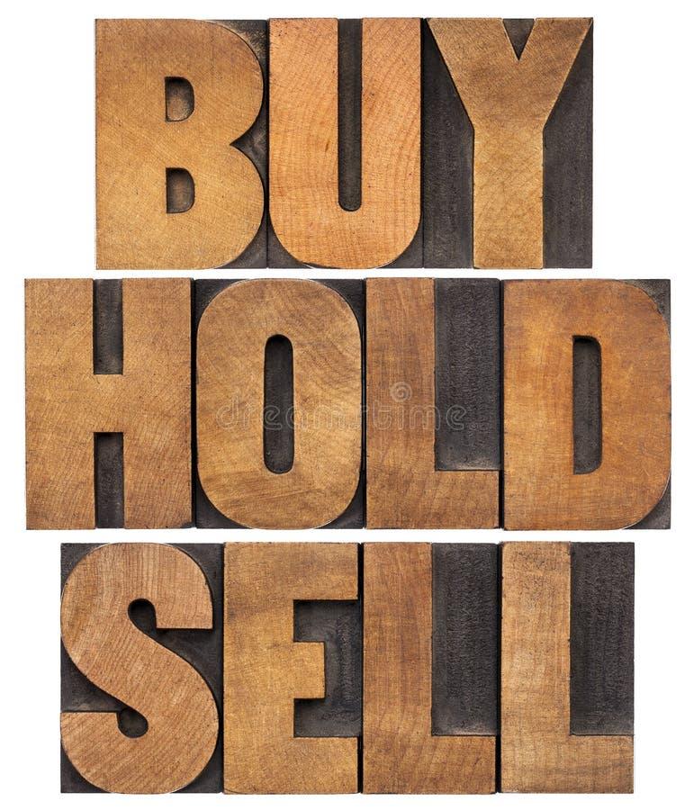 Αγοράστε, κρατήστε, πωλήστε στον ξύλινο τύπο στοκ φωτογραφία με δικαίωμα ελεύθερης χρήσης