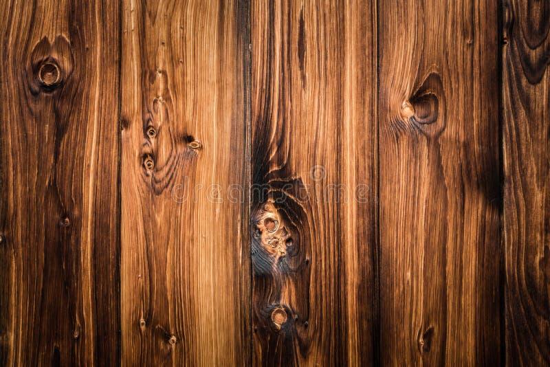 Αγροτικό ξύλινο υπόβαθρο σανίδων με συμπαθητικό vignetting στοκ εικόνες