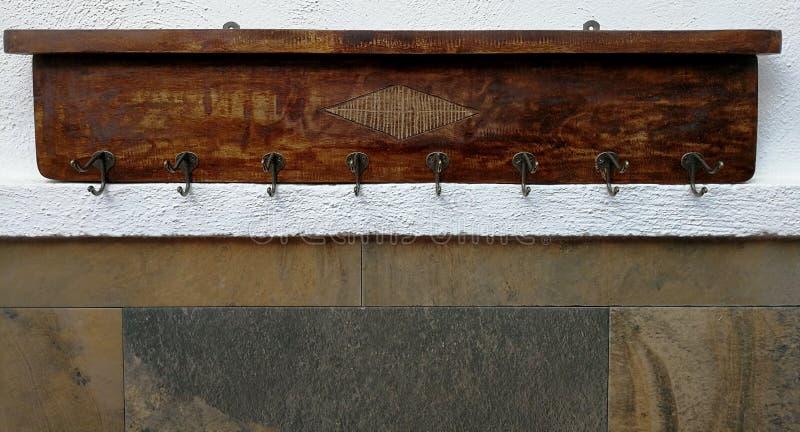 Αγροτικό ράφι παλτών με οκτώ γάντζους στοκ εικόνα