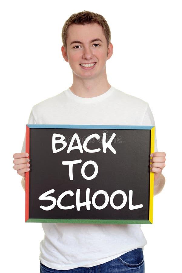 Αγόρι εφήβων πίσω στο σχολικό σημάδι στοκ εικόνα με δικαίωμα ελεύθερης χρήσης