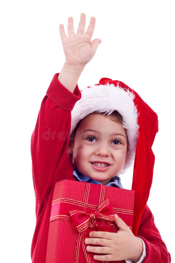 Αγόρι και παρόν Χριστουγέννων στοκ εικόνα
