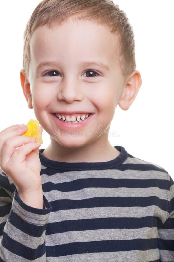 Αγόρι με την καραμέλα στοκ εικόνες