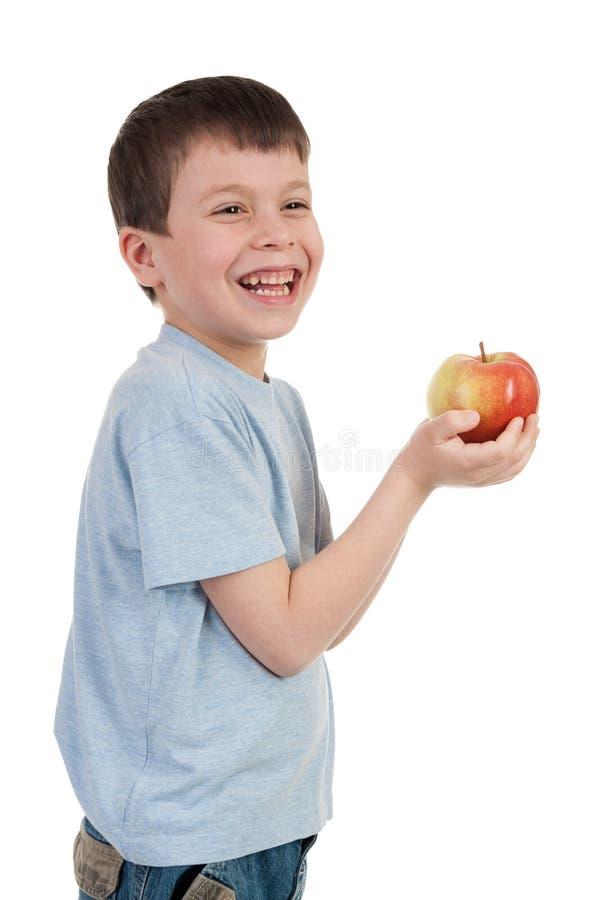Αγόρι με το μήλο στο λευκό στοκ φωτογραφία