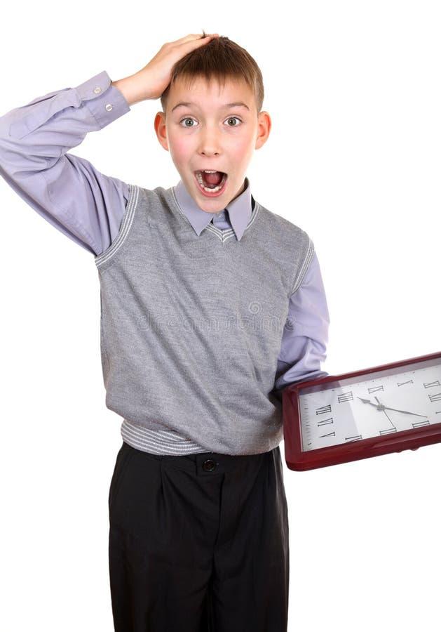Αγόρι με το μεγάλο ρολόι στοκ φωτογραφίες