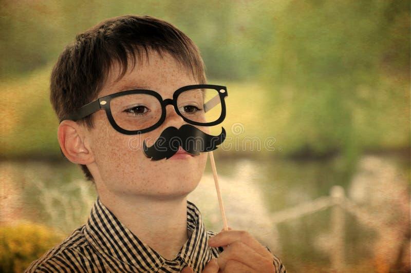 Αγόρι με το moustache στοκ φωτογραφία