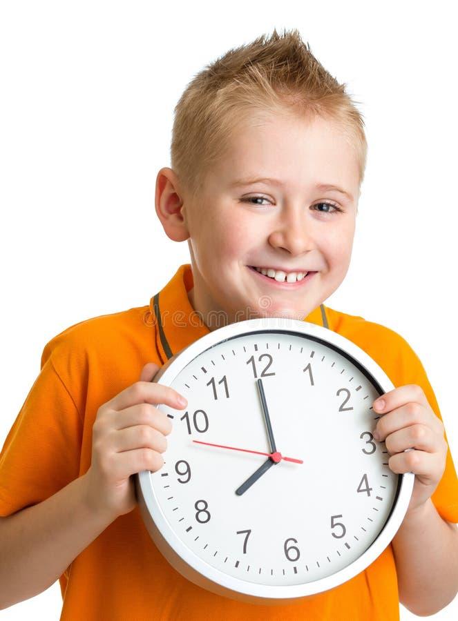 Αγόρι που επιδεικνύει οκτώ η ώρα χρονικές στο στούντιο που απομονώνεται στοκ φωτογραφίες με δικαίωμα ελεύθερης χρήσης