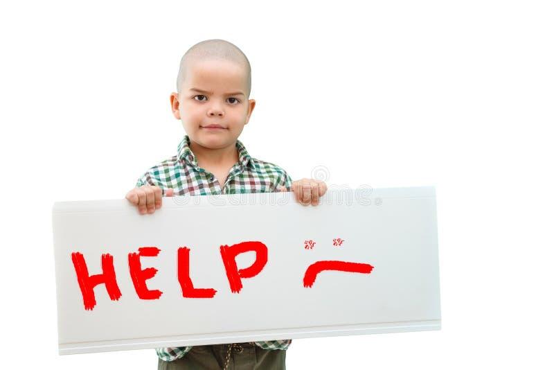Αγόρι που κρατά ένα σημάδι στοκ εικόνα με δικαίωμα ελεύθερης χρήσης