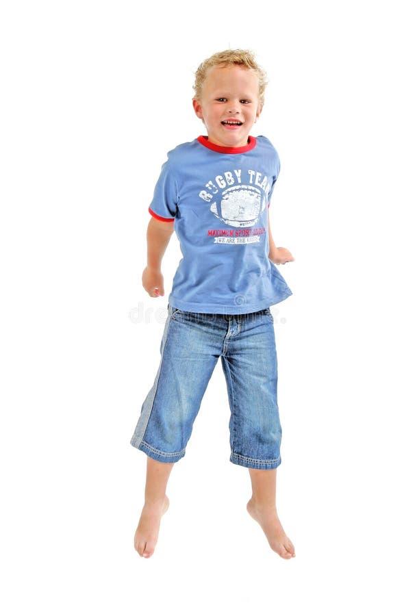 αγόρι που πηδά ελάχιστα Στοκ Εικόνες