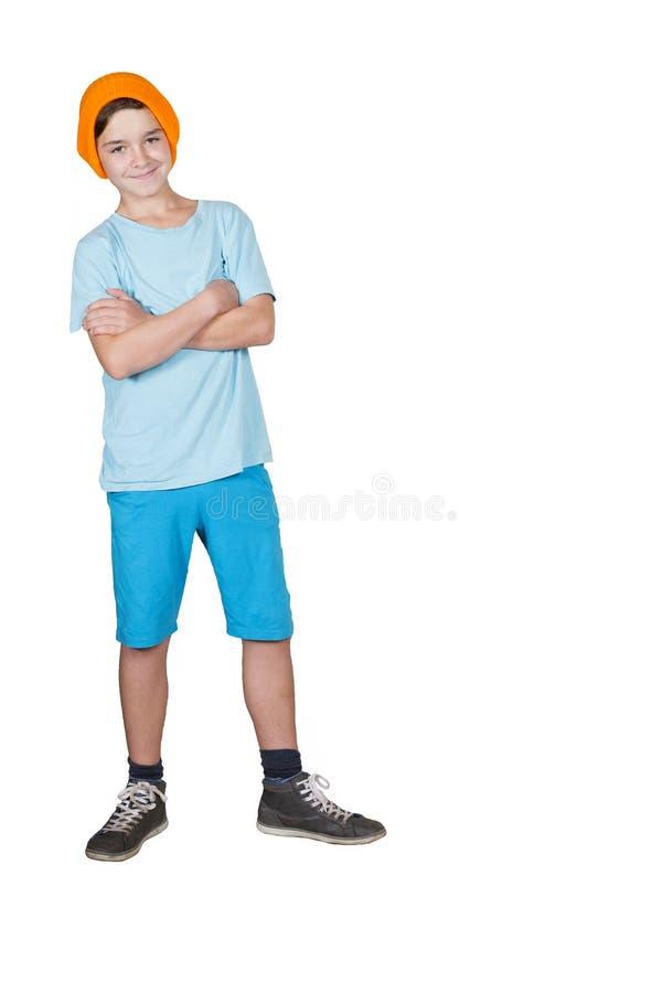 Αγόρι που στέκεται και που χαμογελά στοκ εικόνες