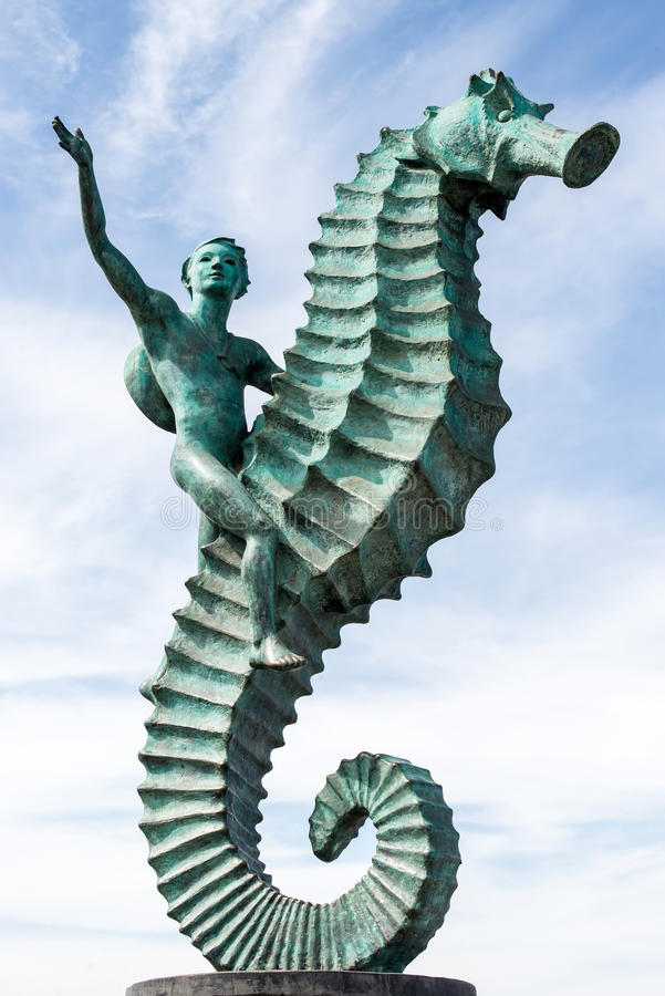 Αγόρι σε ένα Seahorse στοκ εικόνες