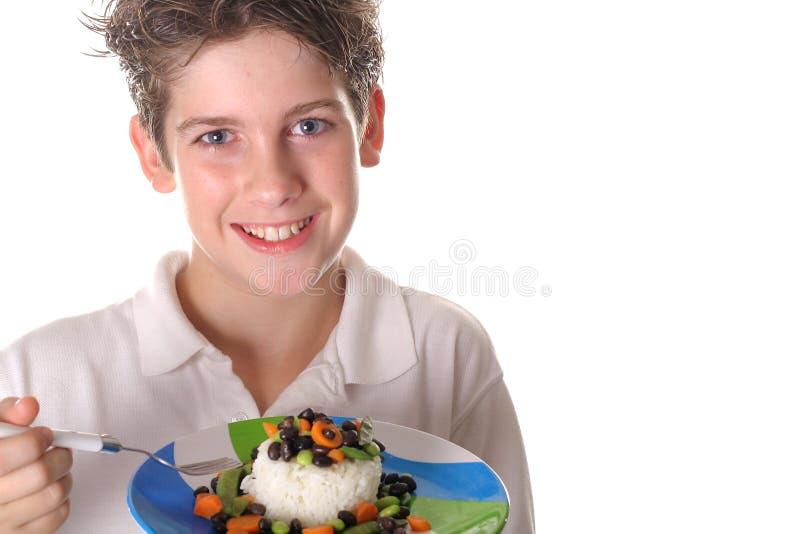 αγόρι φασολιών που τρώει τ στοκ φωτογραφία με δικαίωμα ελεύθερης χρήσης