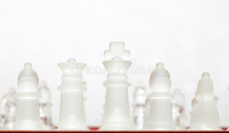 Αδιαφανή κομμάτια σκακιού γυαλιού στοκ φωτογραφία με δικαίωμα ελεύθερης χρήσης