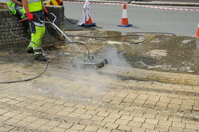 Αεριωθούμενος καθαριστής πλυσίματος ατμού στο sidwalk στοκ εικόνες με δικαίωμα ελεύθερης χρήσης