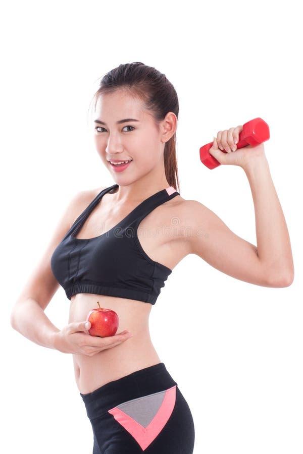 Αθλήτρια με την ανύψωση των βαρών και το κράτημα του μήλου στοκ φωτογραφίες με δικαίωμα ελεύθερης χρήσης