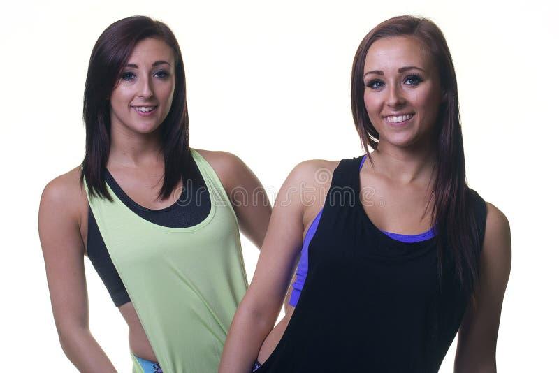 Αθλητικά δίδυμα θηλυκά στοκ εικόνες