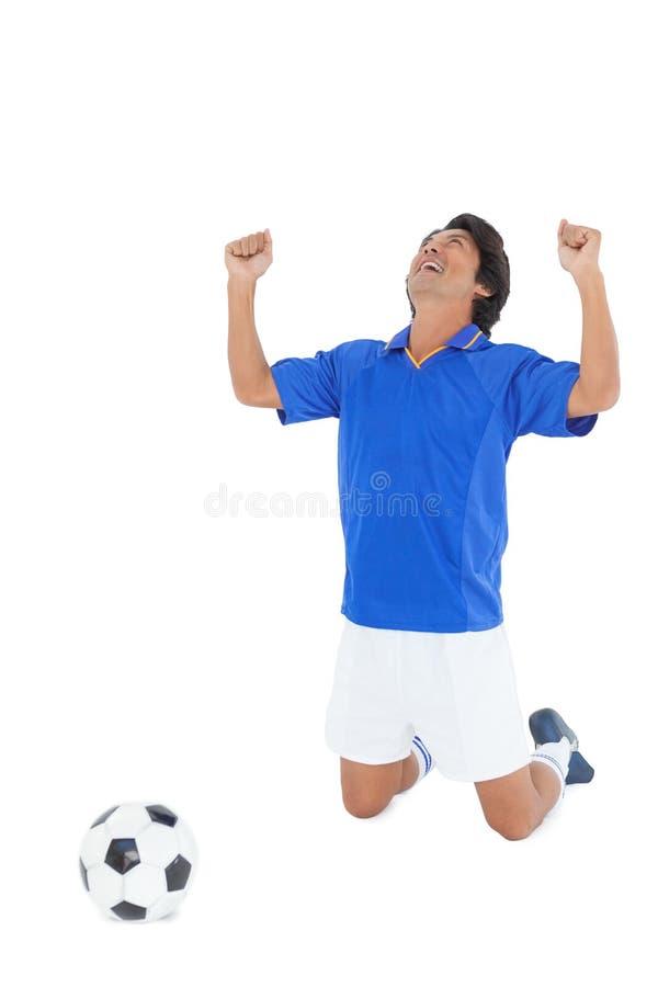 Αθλητικός ποδοσφαιριστής ενθαρρυντικός στοκ εικόνες