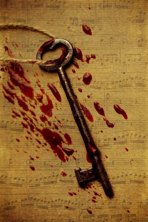 Αιματηρό κλειδί σκελετών με τη μουσική στοκ εικόνα