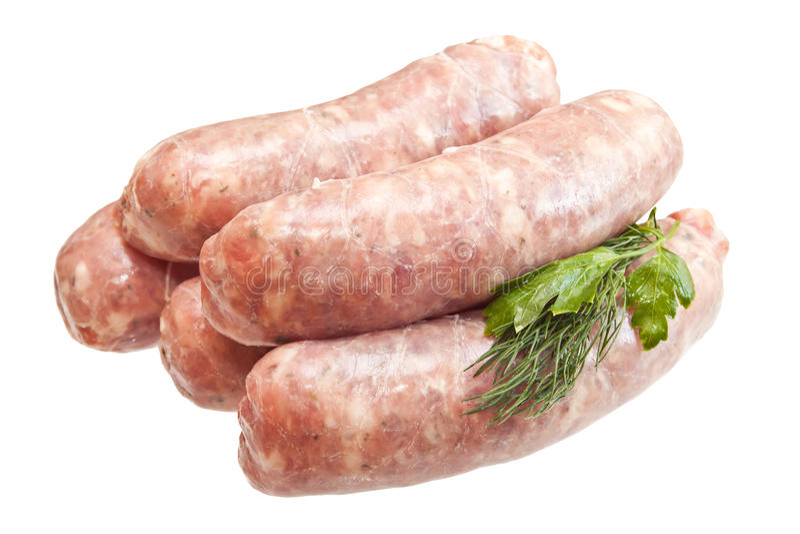 Ακατέργαστα λουκάνικα κρέατος με τα πράσινα στοκ εικόνες με δικαίωμα ελεύθερης χρήσης