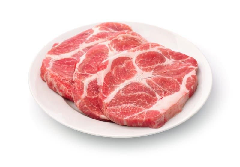 Ακατέργαστες φρέσκες μπριζόλες κρέατος λαιμών χοιρινού κρέατος στοκ εικόνες