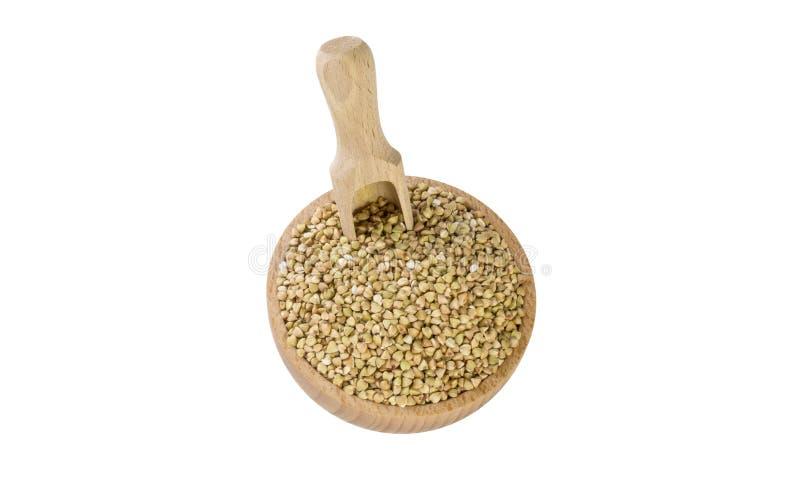 Ακατέργαστο φαγόπυρο στο ξύλινο κύπελλο και σέσουλα που απομονώνεται στο άσπρο υπόβαθρο διατροφή βιο φυσικό συστατικό τροφίμων r στοκ εικόνα