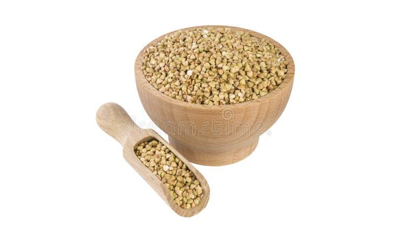 Ακατέργαστο φαγόπυρο στο ξύλινο κύπελλο και σέσουλα που απομονώνεται στο άσπρο υπόβαθρο διατροφή βιο φυσικό συστατικό τροφίμων στοκ φωτογραφία